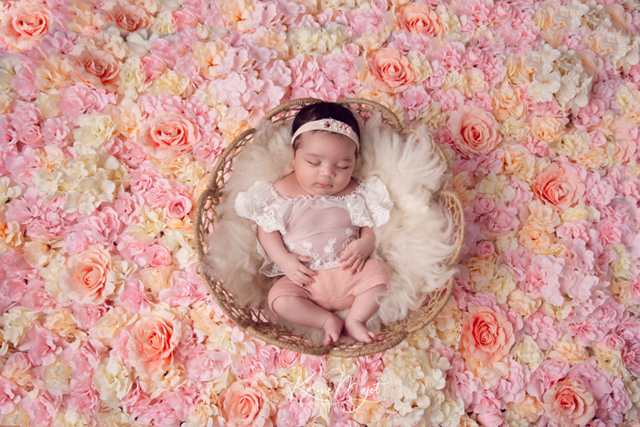 newborn photo session paris baby girl in a basket surrounded with flowers karine majet