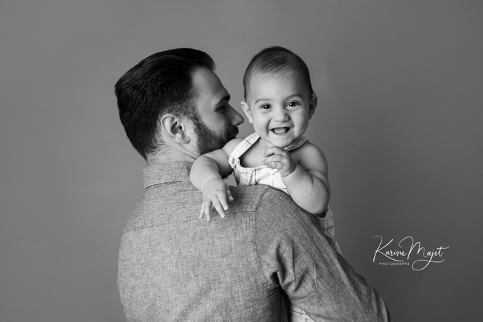 baby photographer garches great pictures with dad by karine majet photographer