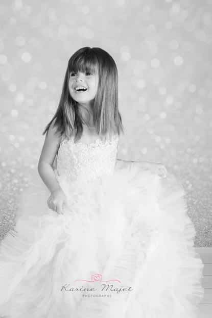 Christmas photo session 5 year old girl dancing with lovely dress black and white