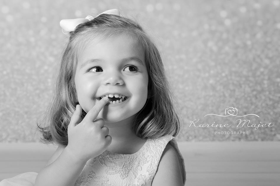 christmas photo session little girl smiling black and white picture