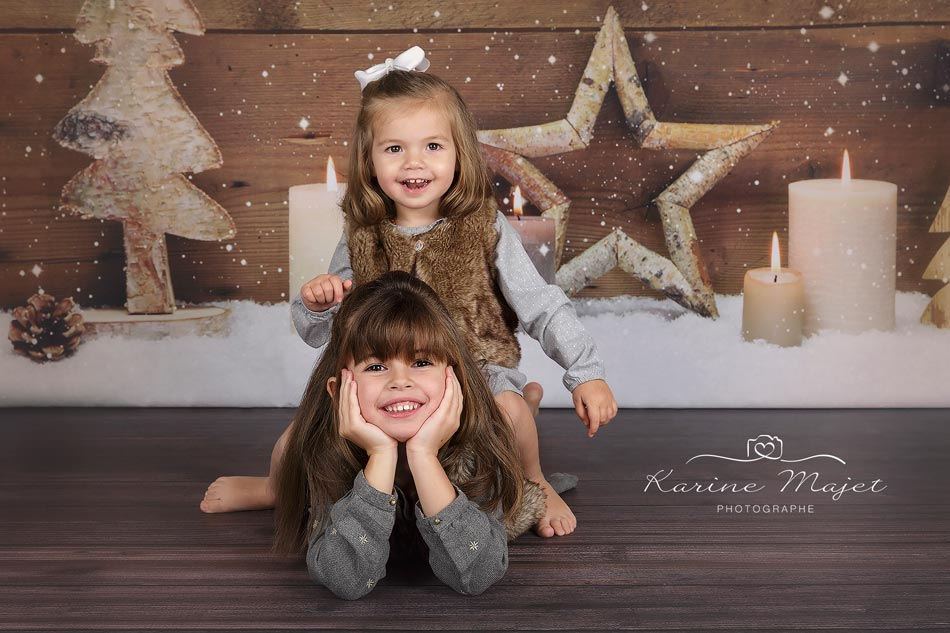 Christmas photo session two sisters on wood background
