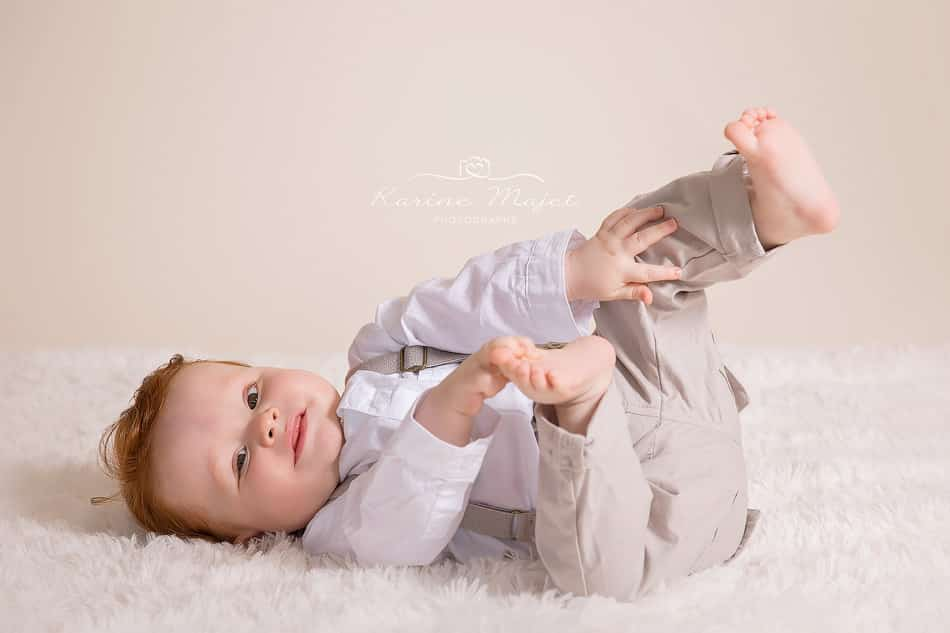 8 month baby photo shoot baby boy playing on the floor
