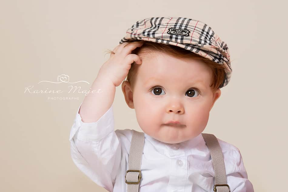 8 month baby photo shoot baby boy portrait with newspaper cap