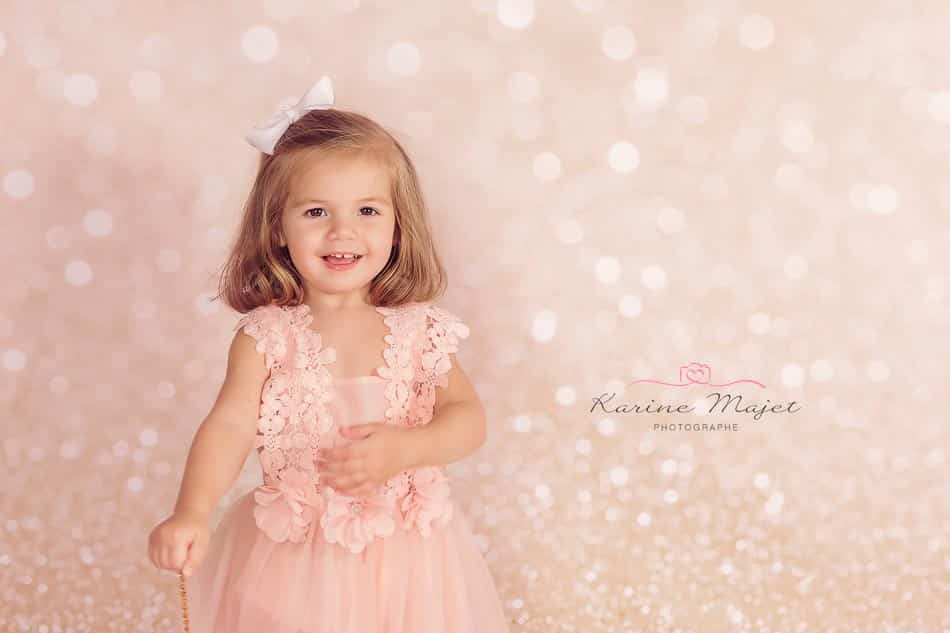 Christmas photo session 2 year old girl smiling