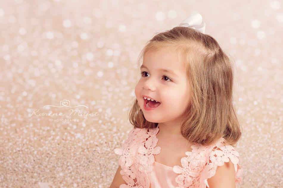 Christmas photo session fantastic little girl portrait on golden background