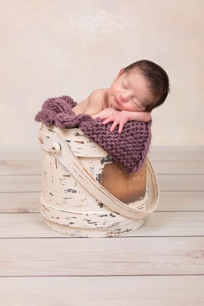 newborn photos baby in wooden bucket studio poto